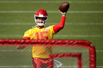 Kansas City Chiefs quarterback Patrick Mahomes throws the ball at a target during NFL football training camp Saturday, July 27, 2019, in St. Joseph, Mo. (AP Photo/Charlie Riedel)