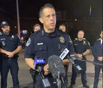This photo provided by Austin Police Department shows Chief Chacon providing an update on overnight shootings in Austin, Texas, early Saturday, June 12, 2021.  Chacon says gunfire erupted in a busy entertainment district downtown early Saturday injuring several.   (Austin Police Department via AP)