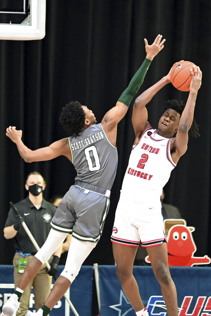 Western Kentucky forward Kevin Osawe (2) grabs a rebound over UAB guard Tyreek Scott-Grayson (0) in the first half of an NCAA college basketball game in the Conference USA men's tournament, in Frisco, Texas, Friday, March 12, 2021. AP Photo/Matt Strasen)