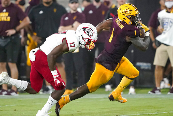 Arizona State running back DeaMonte Trayanum (1) breaks free for a touchdown as Southern Utah cornerback Alonzo Davis (17) defends during the first half of an NCAA college football game, Thursday, Sept. 2, 2021, in Tempe, Ariz. (AP Photo/Matt York)