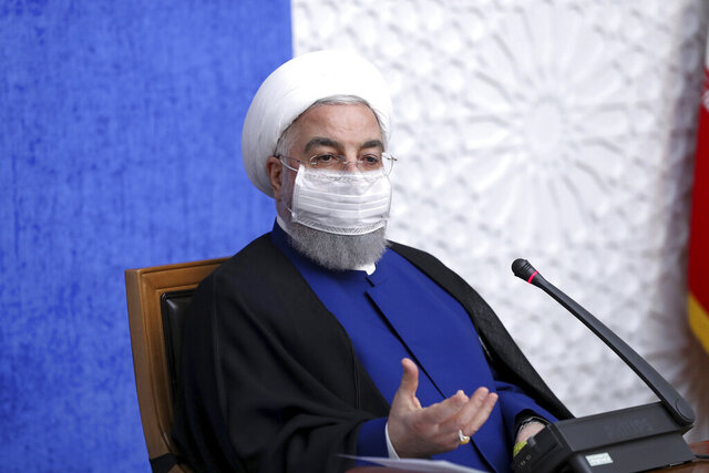 In this photo released by the official website of the office of the Iranian Presidency, President Hassan Rouhani speaks in a meeting in Tehran, Iran, Sunday, Nov. 8, 2020. On Sunday, Rouhani called on President-elect Joe Biden to