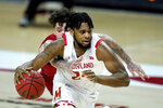 Maryland forward Donta Scott, front, drives as Nebraska guard Teddy Allen tries to swipe the ball away during the second half of an NCAA college basketball game, Wednesday, Feb. 17, 2021, in College Park, Md. (AP Photo/Julio Cortez)