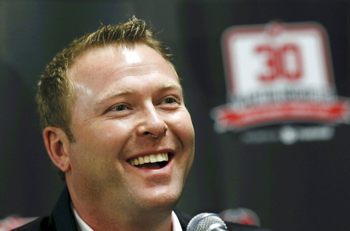 FILE - In this Feb. 9, 2016, file photo, former New Jersey Devils star goalie Martin Brodeur smiles as he talks about his career with the NHL hockey club during a news conference in Newark, N.J. Brodeur returning to the place he spent the vast majority of his Hall of Fame career began a trend of executives going home to work for organizations they were synonymous with.  (AP Photo/Mel Evans, File)