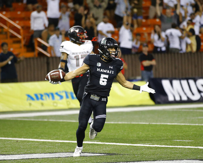 Hawaii wide receiver Cedric Byrd (6) reacts after making the game winning touchdown against UNLV during the fourth quarter of an NCAA college football game, Saturday, Nov. 17, 2018, in Honolulu. Hawaii defeated UNLV 35-28. (AP Photo/Marco Garcia)