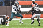 Philadelphia Eagles quarterback Carson Wentz (11) scrambles during the first half of an NFL football game against the Cleveland Browns, Sunday, Nov. 22, 2020, in Cleveland. (AP Photo/David Richard)