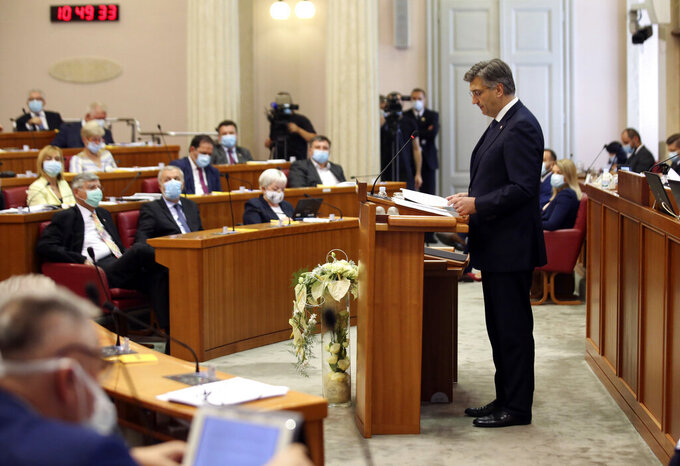 Croatia's Prime Minister incumbent Andrej Plenkovic presents his new government's plan before the Croatian Parliament in Zagreb, Croatia Thursday, July 23, 2020. Parliament vote on Croatian new government is expected later in the day. (AP Photo/Daniel Kasap)