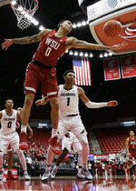 Washington State forward Isaiah Wade (0) grabs a rebound in front of Colorado guard Tyler Bey (1) during the second half of an NCAA college basketball game in Pullman, Wash., Wednesday, Feb. 20, 2019. Washington State won 76-74. (AP Photo/Young Kwak)