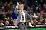 Philadelphia 76ers coach Brett Brown gestures during the second half of the team's NBA basketball game against the Washington Wizards, Thursday, Dec. 5, 2019, in Washington. (AP Photo/Nick Wass)