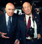 FILE - In this Monday, April 11, 2011 file photo, retired NASA astronaut Thomas Stafford, left, and retired Russian cosmonaut Alexei Leonov visit an exhibition dedicated to the 50th anniversary of the first man in space in Moscow, Russia. Alexei Leonov, the first human to walk in space, died in Moscow on Friday, Oct. 11, 2019. He was 85. (AP Photo/Alexander Zemlianichenko, File)