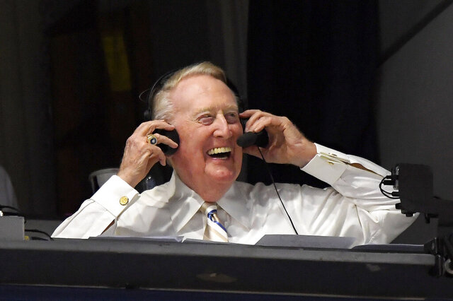 FILE - In this Sept. 19, 2016, file photo, Los Angeles Dodgers Hall of Fame announcer Vin Scully puts his headset on prior to a baseball game between the Dodgers and the San Francisco Giants in Los Angeles. Scully has culled items from his personal collection of memorabilia for auction on Sept. 23. (AP Photo/Mark J. Terrill, File)