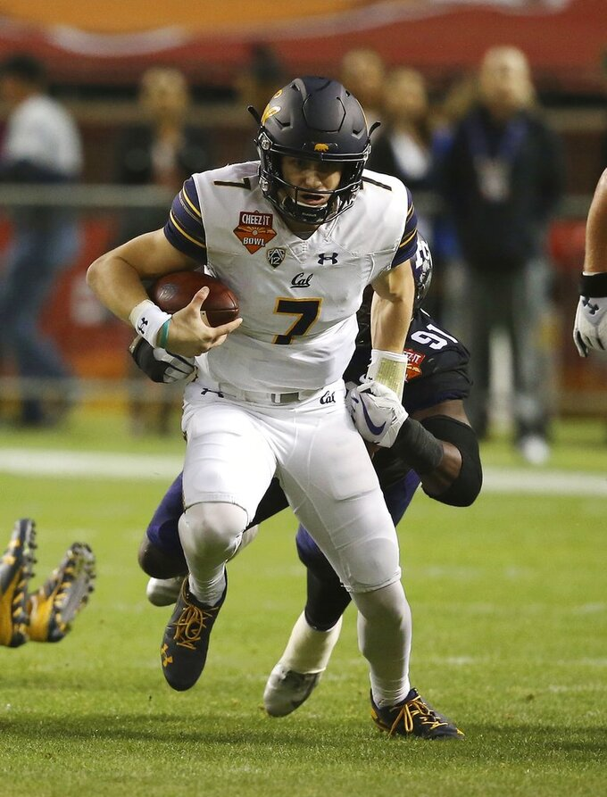 California quarterback Chase Garbers (7) gets brought down by TCU defensive end L.J. Collier (91) during the first half of the Cheez-It Bowl NCAA college football game Wednesday, Dec. 26, 2018, in Phoenix. (AP Photo/Ross D. Franklin)