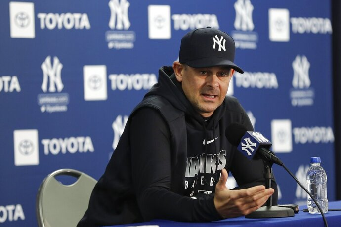 New York Yankees manager Aaron Boone speaks during a news conference before the start of spring training baseball Wednesday, Feb. 12, 2020, in Tampa, Fla. (AP Photo/Frank Franklin II)