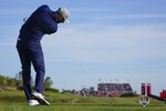 Team USA's Dustin Johnson hits a shot off the tee during a foursome match the Ryder Cup at the Whistling Straits Golf Course Friday, Sept. 24, 2021, in Sheboygan, Wis. (AP Photo/Jeff Roberson)