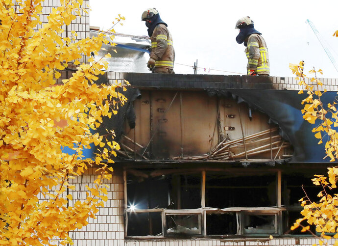 South Korean firefighters check the site of a fire in Seoul, South Korea, Friday, Nov. 9, 2018. A fire at a low-cost dormitory-style housing facility in central Seoul killed several people on Friday, fire authorities said. (Hong Hae-in/Yonhap via AP)