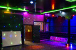 Lights shine at a no longer operative Karaoke hall in Kabul, Afghanistan, Tuesday, Sept. 21, 2021. A month after the Taliban seized power in Afghanistan, the music is starting to go quiet. Some karaoke parlors have closed. Others still open face harassment. (AP Photo/Bernat Armangue)