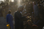 Afghans bet on a traditional wrestling match at the Chaman-e-Hozari Park in Kabul, Afghanistan, Friday, Sept. 17, 2021. (AP Photo/Bernat Armangue)