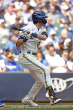 Milwaukee Brewers' Christian Yelich hits a run-scoring double during the fifth inning of a baseball game against the Kansas City Royals, Wednesday, July 21, 2021, in Milwaukee. (AP Photo/Jeffrey Phelps)