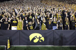 FILE - In this Saturday, Sept. 22, 2018 file photo, Iowa fans wave to children in the University of Iowa Stead Family Children's Hospital at the end of the first quarter of an NCAA college football game against Wisconsin in Iowa City, Iowa. During a season when the atmosphere will be subdued at Iowa home football games because the usual 69,000 fans won't be there, one tradition will go on uninterrupted. At the end of the first quarter, players and coaches from both teams will turn to the University of Iowa Stead Family Children's Hospital and wave, just as they've done every home game since 2017.(AP Photo/Matthew Putney, File)