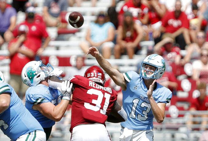 Tulane quarterback Justin Ibieta (13) throws a pass against Oklahoma during a NCAA college football game Saturday, Sept. 4, 2021, in Norman, Okla. (AP Photo/Alonzo Adams)