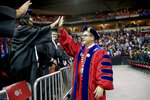In this May 19, 2018, photo provided by California State University, Fresno State President Dr. Joseph Castro greeting graduates during commencement ceremonies at the university in Fresno, Calif. The California State University system has named Fresno State President Dr. Castro as its next chancellor. He replaces outgoing Chancellor Timothy White to become the first Mexican-American and native Californian to lead the nation's largest four-year public university system. California State University's Board of Trustees announced Castro's appointment on Wednesday, Sept. 23, 2020. (Cary Edmondson/California State University via AP)