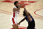 Houston forward Justin Gorham (4) grabs an inbound pass next to Tulsa guard Brandon Rachal during the second half of an NCAA college basketball game Wednesday, Jan. 20, 2021, in Houston. (AP Photo/Eric Christian Smith)
