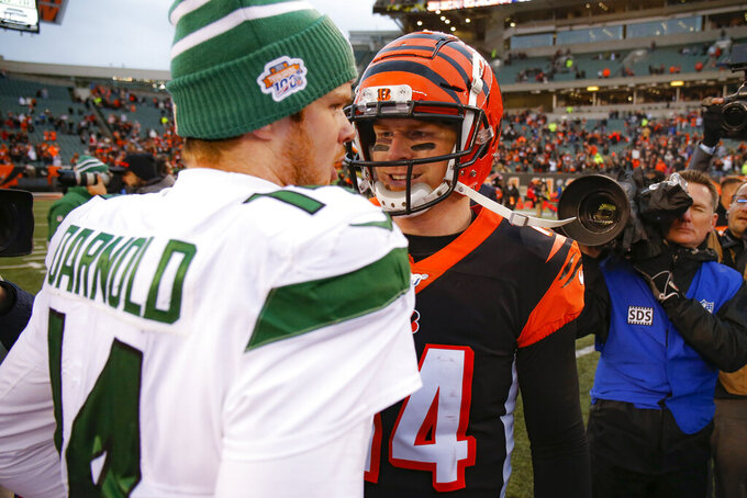 Cincinnati Bengals quarterback Andy Dalton, right, meets with New York Jets quarterback Sam Darnold, left, after an NFL football game, Sunday, Dec. 1, 2019, in Cincinnati. (AP Photo/Gary Landers)