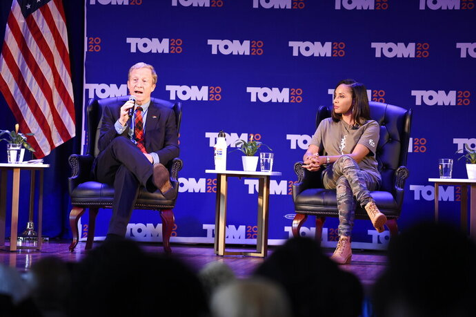 Democratic presidential candidate Tom Steyer, left, next to lyricist MC Lyte, right, speaks at a black women's forum on Tuesday, Dec. 10, 2019, at Allen University in Columbia, S.C. (AP Photo/Meg Kinnard)