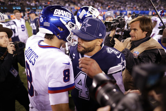 New York Giants quarterback Daniel Jones (8) and Dallas Cowboys quarterback Dak Prescott (4) meet at midfield after an NFL football game, Monday, Nov. 4, 2019, in East Rutherford, N.J. The Cowboys won 37-18. (AP Photo/Adam Hunger)