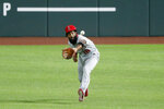 Los Angeles Angels right fielder Brian Goodwin reaches forward to field a sacrifice fly by Texas Rangers' Robinson Chirinos in the second inning of a baseball game in Arlington, Texas, Friday, Aug. 7, 2020. The Rangers' Willie Calhoun scored on the play. (AP Photo/Tony Gutierrez)