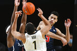 Richmond forward Tyler Burton (3) blocks a shot by Vanderbilt forward Dylan Disu (1) during the second half of an NCAA college basketball game Wednesday, Dec. 16, 2020, in Nashville. Richmond won 78-67. (AP Photo/John Amis)