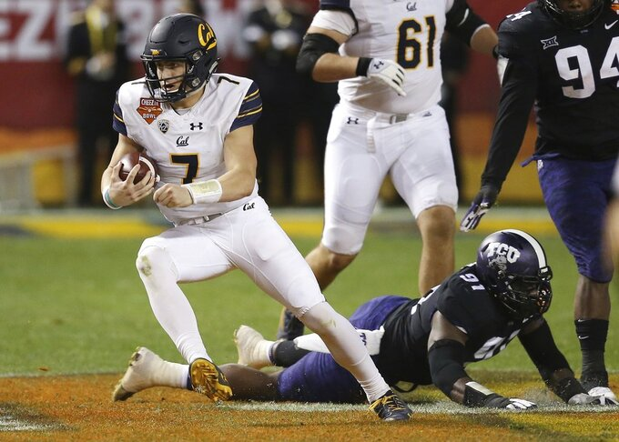 California quarterback Chase Garbers (7) slips past TCU defensive end L.J. Collier (91) during the first half of the Cheez-It Bowl NCAA college football game Wednesday, Dec. 26, 2018, in Phoenix. (AP Photo/Ross D. Franklin)