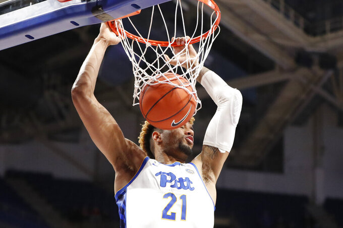 Pittsburgh's Terrell Brown dunks against Florida State during the second half of an NCAA college basketball game Wednesday, Nov. 6, 2019, in Pittsburgh. Pittsburgh won 63-61. (AP Photo/Keith Srakocic)