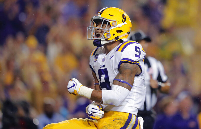 FILE - In this Sept. 29, 2018, file photo, LSU safety Grant Delpit (9) celebrates his sack of Mississippi quarterback Jordan Ta'amu during the first half of an NCAA college football game, in Baton Rouge, La. Delpit was named to The Associated Press Midseason All-America team, Tuesday, Oct. 16, 2018. (AP Photo/Gerald Herbert, File)