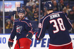 Columbus Blue Jackets forward Boone Jenner (38) celebrates his goal with forward Liam Foudy (19) during the second period of an NHL hockey game against the Buffalo Sabres, Thursday, Feb. 13, 2020, in Buffalo, N.Y. (AP Photo/Jeffrey T. Barnes)