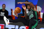 Toronto Raptors' Pascal Siakam, background, is called for a foul as he angles with Boston Celtics' Marcus Smart (36) during the second half of an NBA conference semifinal playoff basketball game Monday, Sept. 7, 2020, in Lake Buena Vista, Fla. (AP Photo/Mark J. Terrill)