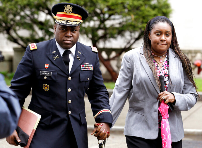FILE - In this May 9, 2013, file photo, John Jackson, left, and his wife, Carolyn Jackson, of Mount Holly, N.J., walk out of a courthouse in Newark, N.J. The couple, who've been convicted of abusing their young foster children over several years, face another sentencing after a federal appeals court ruled their earlier sentences were too lenient. (AP Photo/Julio Cortez, File)