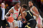 Houston guard DeJon Jarreau (3) drives around Wichita State guard Tyson Etienne (1) during the first half of an NCAA college basketball game Sunday, Feb. 9, 2020, in Houston. (AP Photo/Michael Wyke)