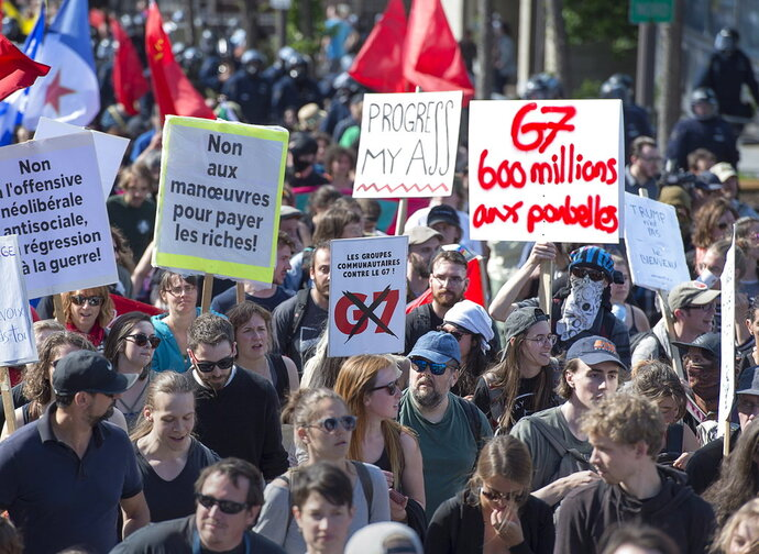 Demonstrators march in Quebec City as they protest the annual summit of G7 leaders on Saturday, June 9, 2018. Leaders of major industrialized nations met in a resort town north of Quebec City after days of escalating conflict over new U.S. tariffs. (Andrew Vaughan/The Canadian Press via AP)
