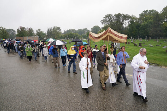 Churchgoers participate in a procession at the Holy Apostles Church in Milwaukee, Saturday, Sept. 12, 2020. For decades, Roman Catholic voters have been a pivotal swing vote in U.S. presidential elections, with a majority backing the winner — whether Republican or Democrat — nearly every time. (AP Photo/Morry Gash)