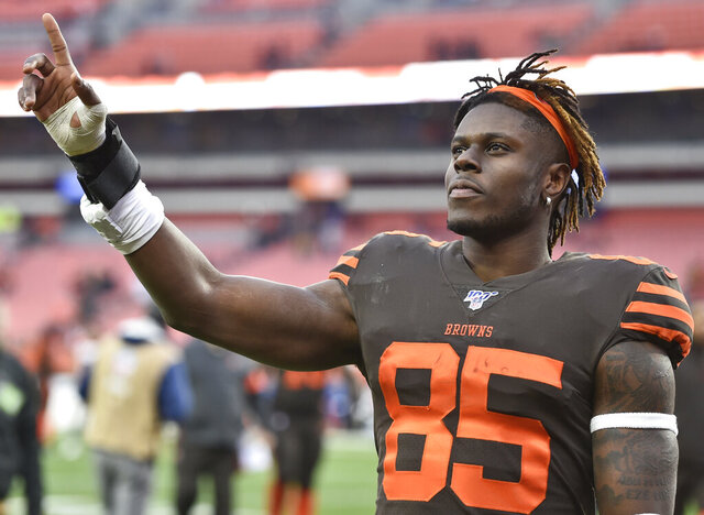 FILE - Cleveland Browns tight end David Njoku celebrates after the Browns defeated the Cincinnati Bengals 27-19 in an NFL football game, Dec. 8, 2019 in Cleveland. Agent Drew Rosenhaus has asked the Browns to trade tight end and former first-round draft pick David Njoku, a person familiar with the request told the Associated Press on Friday, July 3, 2020. (AP Photo/David Richard, file)