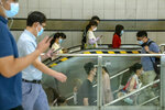 People wearing face masks to protect against COVID-19 walk through a subway station during the morning rush hour in Beijing, Wednesday, Aug. 4, 2021. The coronavirus's delta variant is challenging China's costly strategy of isolating cities, prompting warnings that Chinese leaders who were confident they could keep the virus out of the country need a less disruptive approach. (AP Photo/Mark Schiefelbein)