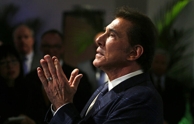 FILE - In this March 15, 2016, file photo, former Las Vegas casino mogul Steve Wynn gestures during a news conference in Medford, Mass. Wynn won a battle in a legal fight about whether Nevada gambling regulators can fine him over allegations of workplace sexual misconduct even though he no longer is licensed or involved in the gambling industry. A Wynn attorney declined Monday, Nov. 23, 2020, to comment about a state court judge's finding that because Wynn has no ties to the casino business, the state Gaming Commission and Gaming Control Board have no jurisdiction over him. (AP Photo/Charles Krupa, File)