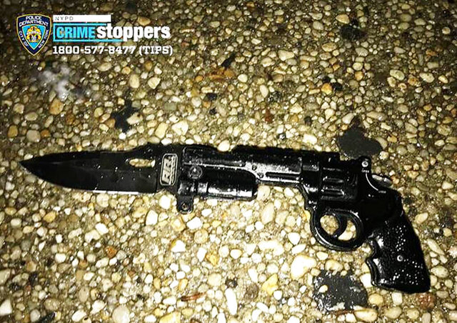 """In this Saturday, Dec. 14, 2019, photo released by the New York Police Dept., an imitation gun-like knife is displayed after it was recovered in a shooting. Police say two New York City officers shot and wounded a man wielding an """"imitation firearm"""" in the Bronx. Authorities said at a press conference following the shooting early Saturday that the man was in critical condition. (New York Police Dept. via AP)"""