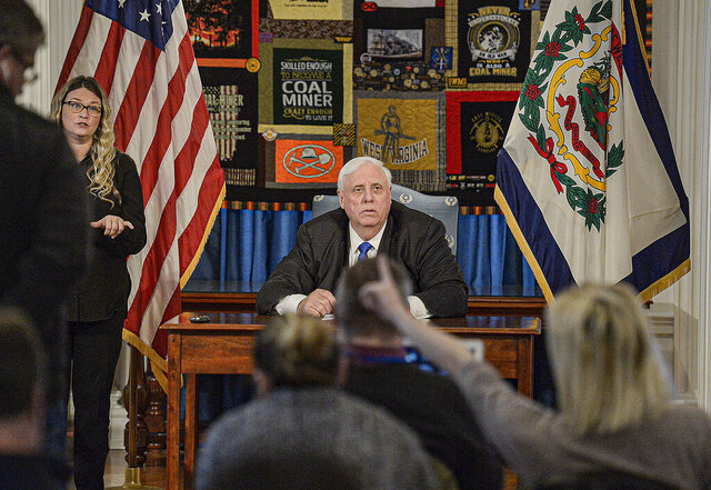 West Virginia Gov. Jim Justice holds a Monday March 16, 2020 news conference at the West Virginia Capitol in Charleston, W.Va. The West Virginia Education Association filed a court challenge Monday, Oct. 5, 2020, to the state's color-coded map that determines whether counties can hold in-person public school classes during the coronavirus pandemic. The union wants to replace the school reentry map that has undergone multiple changes by Republican Gov. Jim Justice and state officials with one compiled by independent health experts. (F. Brian Ferguson/Charleston Gazette-Mail via AP)