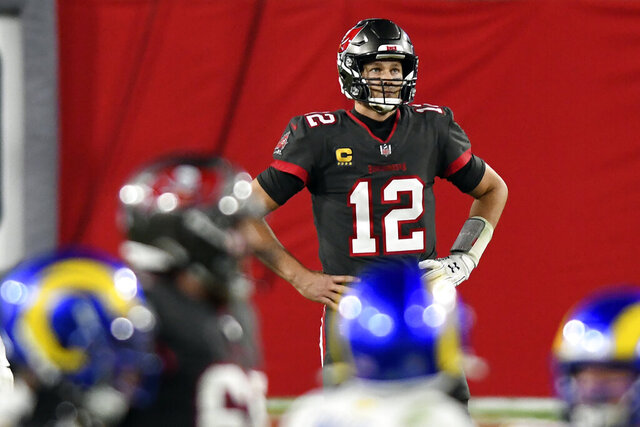 Tampa Bay Buccaneers quarterback Tom Brady (12) reacts after throwing an interception to Los Angeles Rams strong safety Jordan Fuller during the second half of an NFL football game Monday, Nov. 23, 2020, in Tampa, Fla. (AP Photo/Jason Behnken)