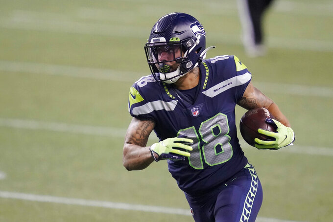 Seattle Seahawks wide receiver Freddie Swain runs for a touchdown after a reception against the New England Patriots during the second half of an NFL football game, Sunday, Sept. 20, 2020, in Seattle. (AP Photo/Elaine Thompson)