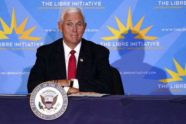 Vice President Mike Pence participates in a Libre Initiative Roundtable at Grand Canyon University, Friday, Sept. 18, 2020, in Phoenix. (AP Photo/Matt York)
