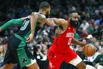 Houston Rockets' James Harden, right, drives past Boston Celtics' Marcus Morris during the second half of an NBA basketball game in Boston, Sunday, March 3, 2019. (AP Photo/Michael Dwyer)