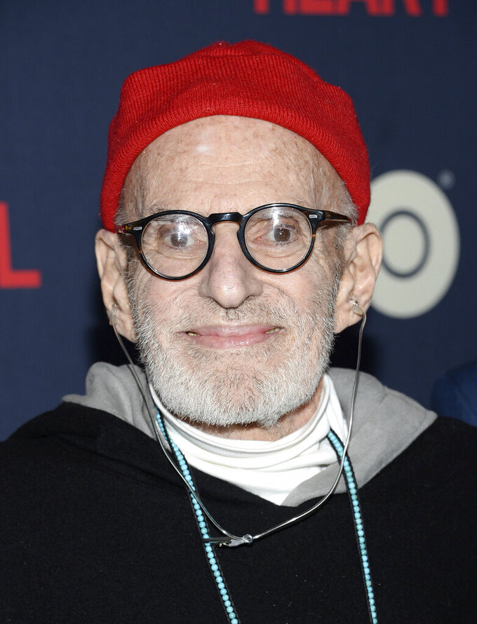 "FILE - This May 12, 2014 file photo shows playwright Larry Kramer at the premiere of HBO Films' ""The Normal Heart"" in New York. Kramer, the playwright whose angry voice and pen raised theatergoers' consciousness about AIDS and roused thousands to militant protests in the early years of the epidemic, died Wednesday, May 27, 2020 in Manhattan of pneumonia. He was 84. (Photo by Evan Agostini/Invision/AP, File)"
