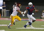 Arizona quarterback Khalil Tate stiff arms Southern California safety Talanoa Hufanga (15) in the second half during an NCAA college football game, Saturday, Sept. 29, 2018, in Tucson, Ariz. Southern California defeated Arizona 24-20. (AP Photo/Rick Scuteri)